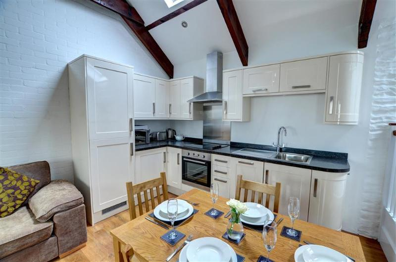 The fitted kitchen, comfortable sitting room with Freeview TV and electric fire