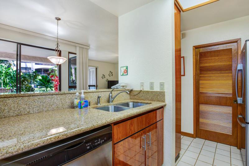 Kitchen with washer and dryer close by