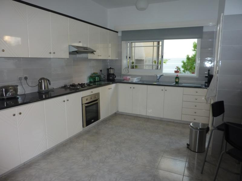 Fully fitted kitchen with access onto rear veranda.
