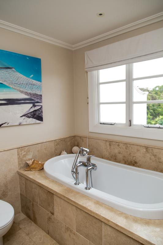 Master bed bathroom with bath