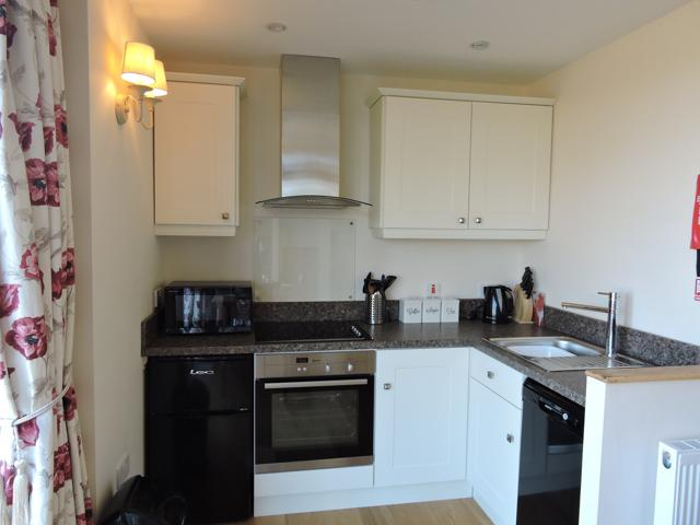 The well equipped kitchen has oven, hob, microwave, toaster, kettle and dishwasher