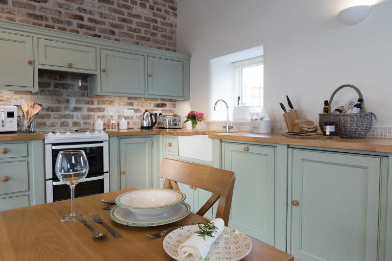 Hand crafted country kitchen, oak wood flooring and underfloor heating.
