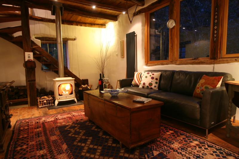 Cosy sitting room with woodturner, Sofa and TV..