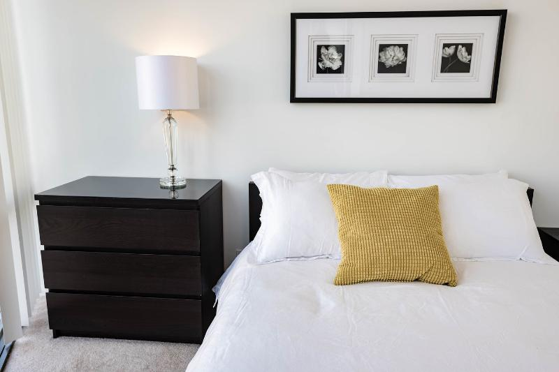 Large second bedroom with double size bed and fresh linens.
