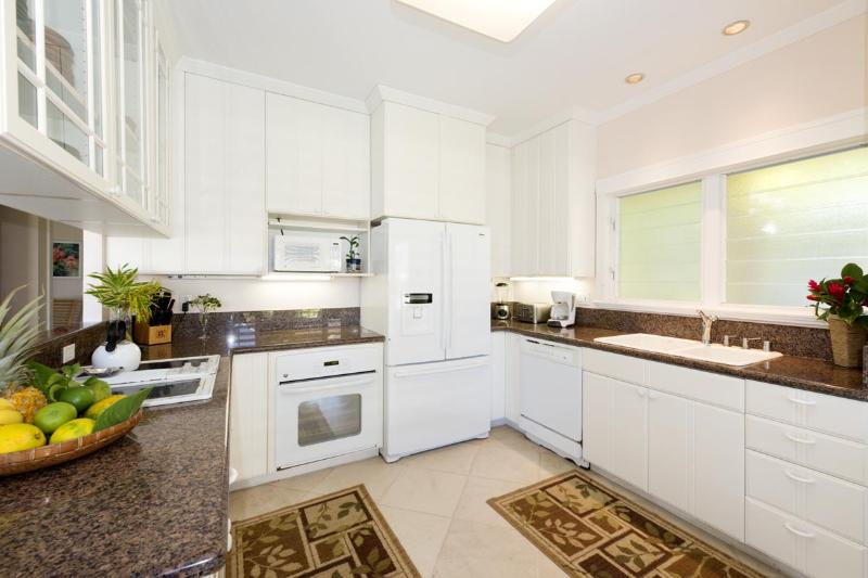 Granite counter tops in the kitchen. Dishwasher, stove, oven and every utensil you might need.