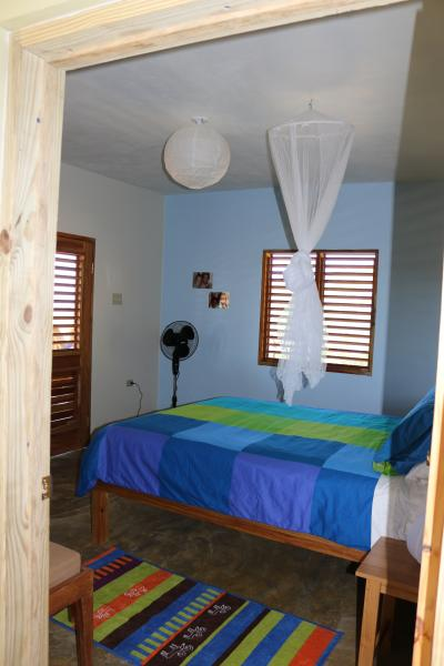 Bedroom 1 with French doors that open to the sea