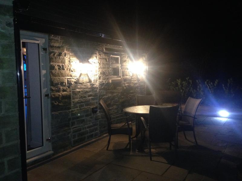 Rear patio evening wall lights and brick lighting