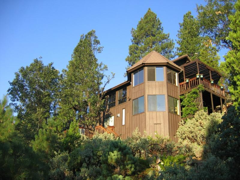 Enjoy this modern home perched high on a hillside only minutes from Yosemite!