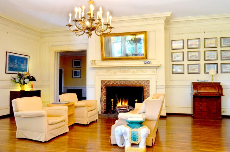 The chandelier dims, the fireplace works, the furniture is shabby chic ...so put your feet up too!