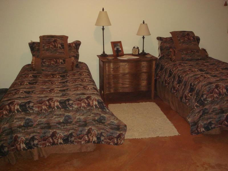 This bedroom has been updated to include a full sized bed and a twin