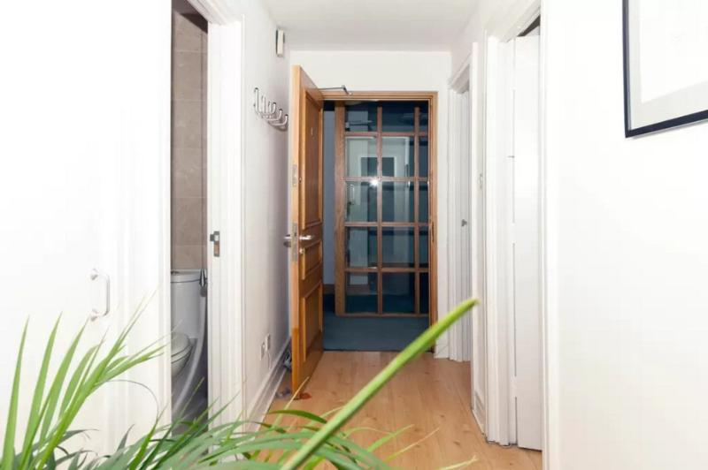 Spacious hallway connects 2 king bedrooms, bathroom, and lounge (which has private door). Wood floor