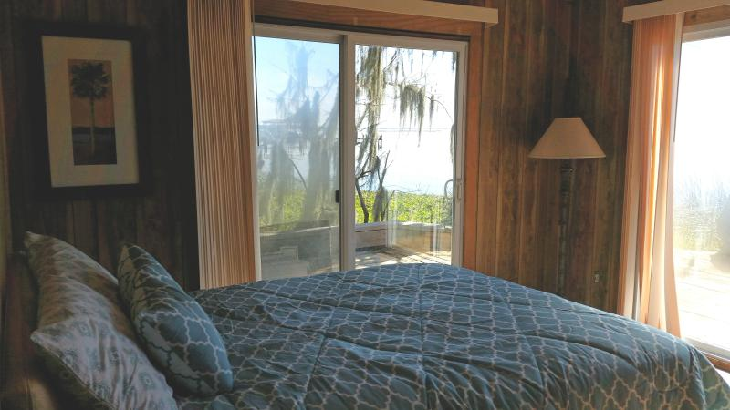 Runaway Bay The Blue Heron Waterfront 2 Bedroom  Bedroom 2 Queen size bed with water view Doors