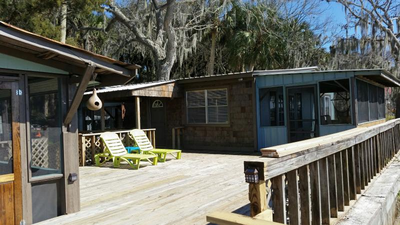 Runaway Bay The Blue Heron Waterfront 2 Bedroom  Exterior of home from sundeck available to guests.