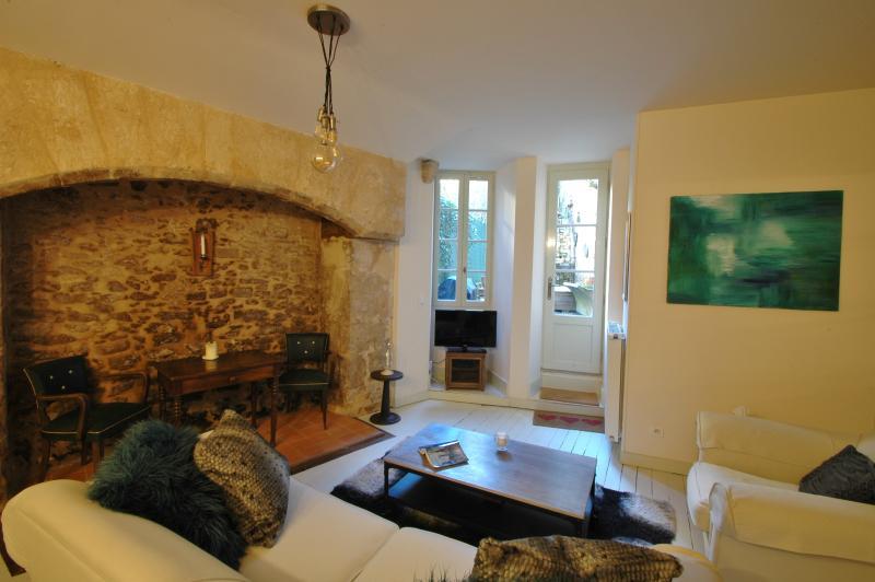 Living/dining area with doorway to courtyard garden.