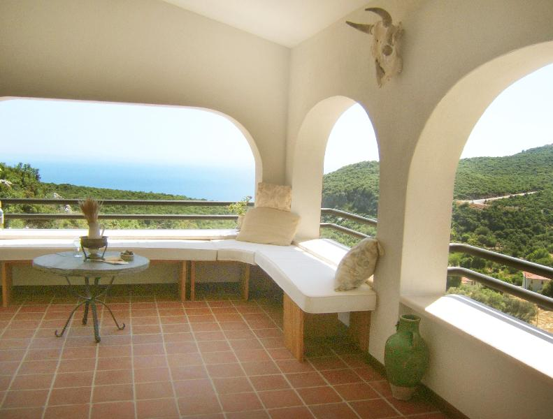 "Covered balcony ""loggia"" overlooks the sea and the valleys"