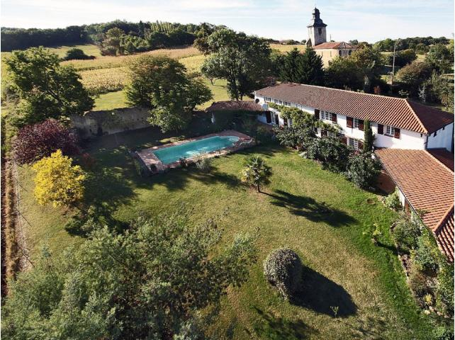 Aerial view of house frontage. More garden behind house.
