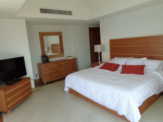 Master bedroom King bed, flat TV.
