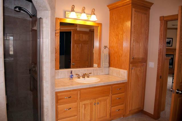 One sink and the shower stall in the master bathroom