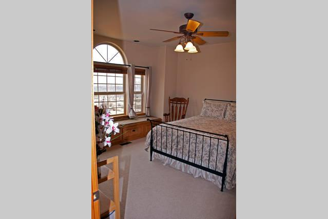 Iron Bedroom with queen bed and bench with views toward Carson Valley