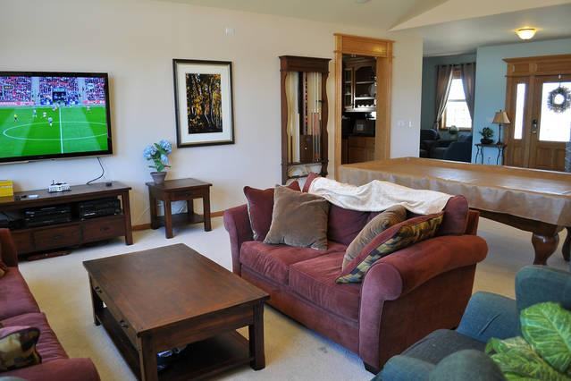 Great room with large TV, oversize couches and pool table