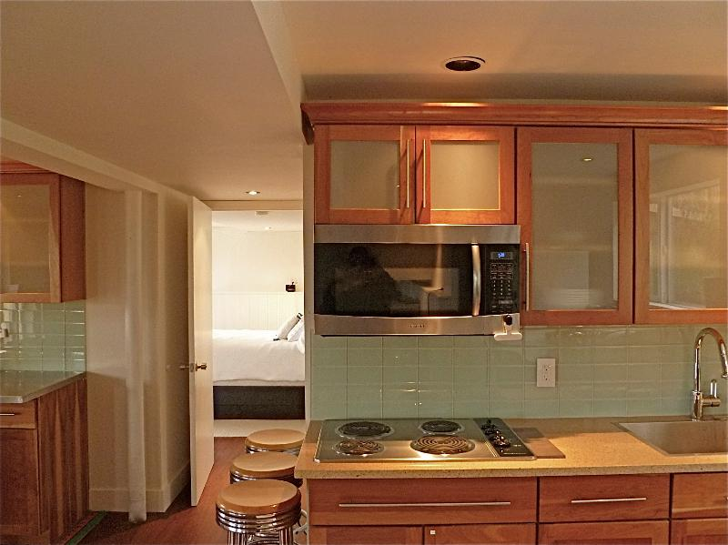 Solid Cherry cabinets w modern glass tiles and engineered granite counters