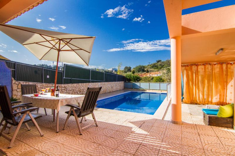 Our pool and patio catch the sun all day until it sets over the hill opposite