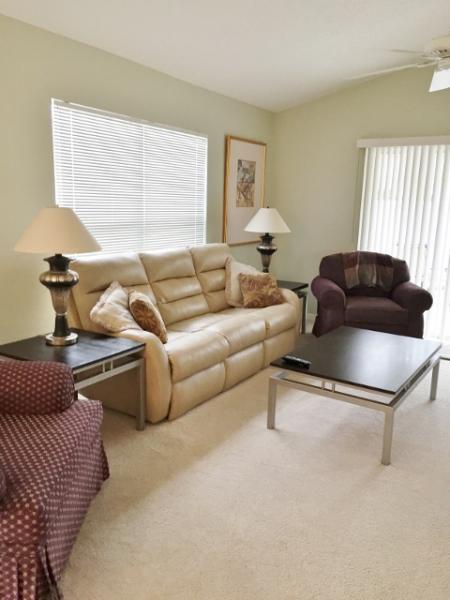 Living room, sofa has 2 recliners.