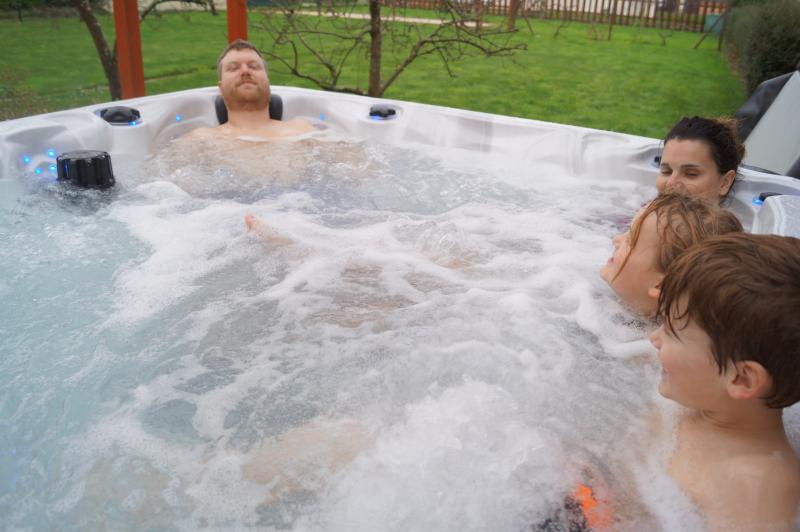 Relaxing in the 5 seater hot tub