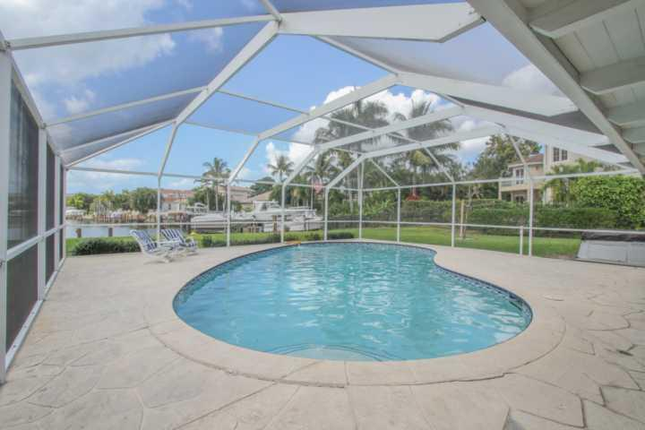 Private, in-ground Pool (not heated) & Boat Dock overlooking Compass Bay in The Moorings, Naples.