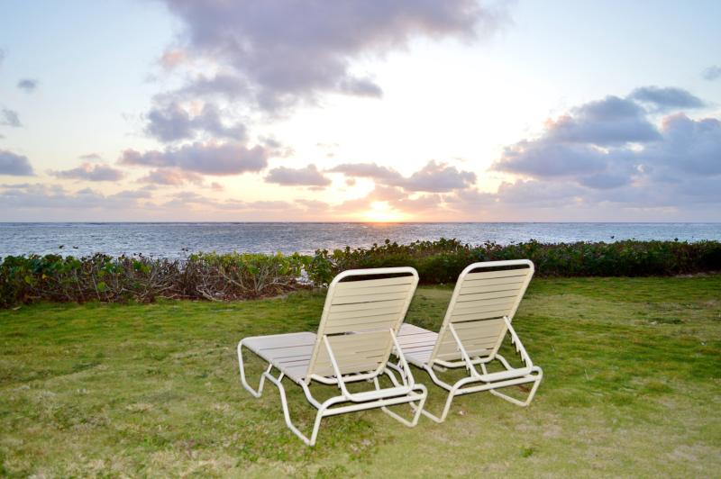Lounge chairs waiting for you at sunrise.