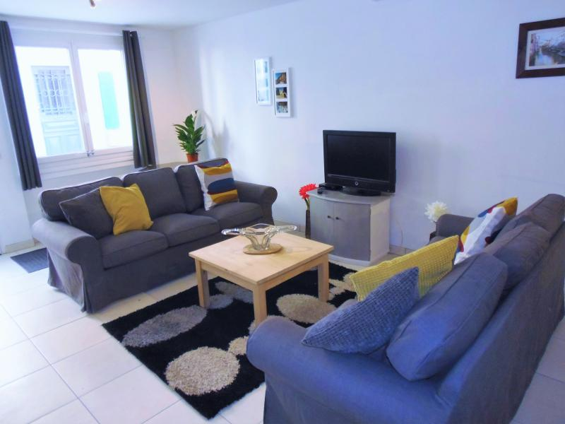 Lounge area with two comfortable three seater sofas