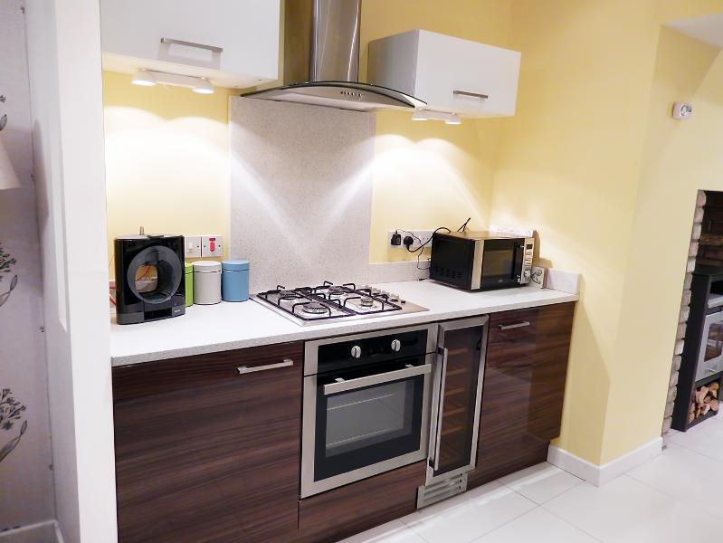 Modern kitchen, gas hob electric oven, dishwasher, wine fridge