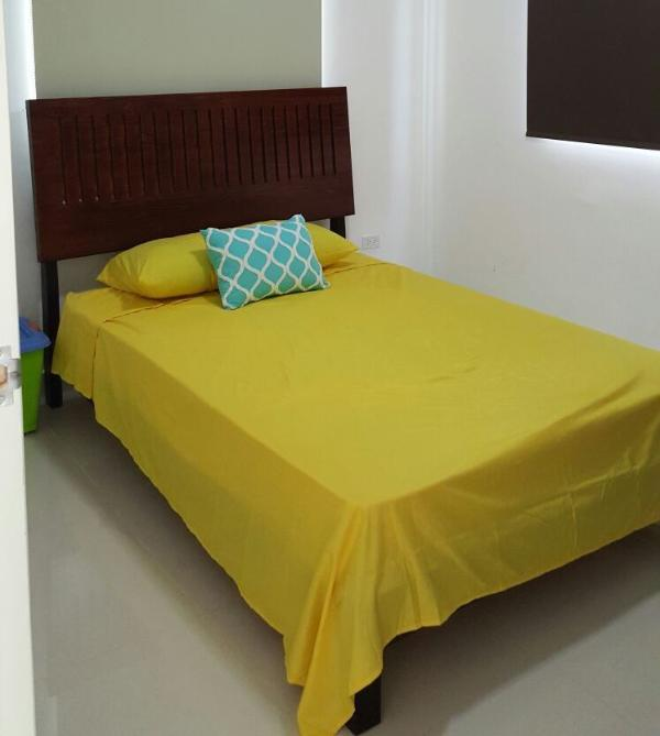 master bedroom includes comfortable bed for two people
