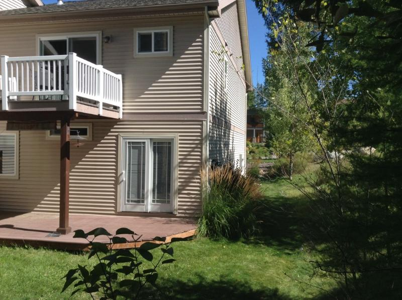 Backyard with deck and balcony