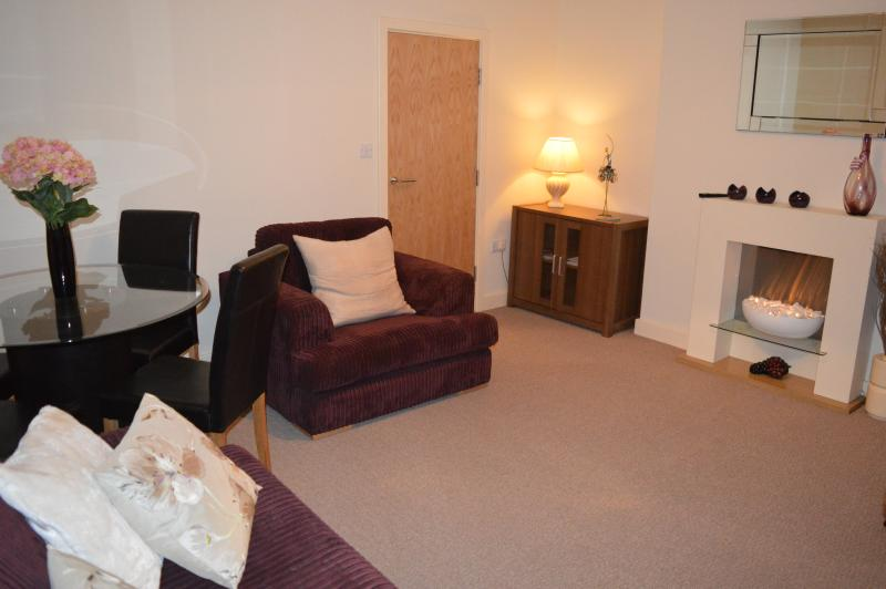 Sitting Room with sofa bed, dining table and 4 chairs, TV & DVD player, radio, electric fire.