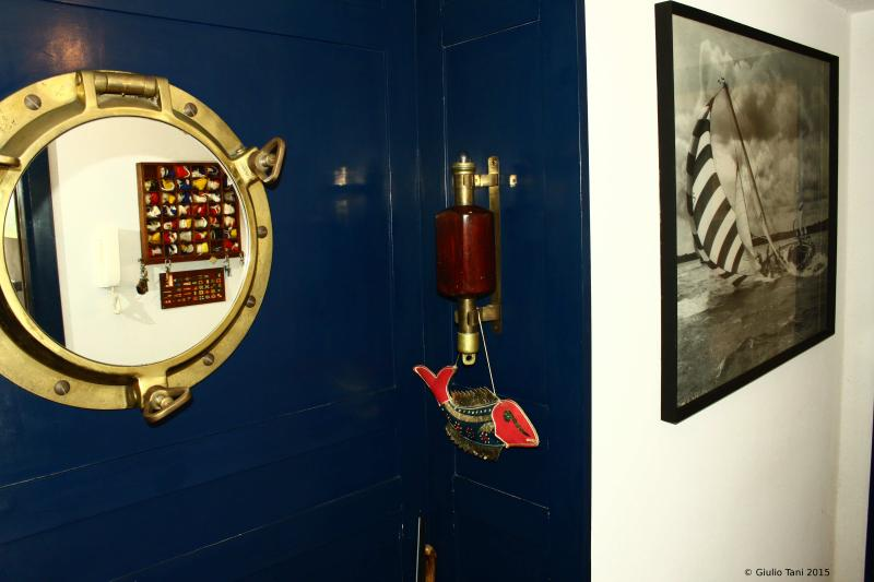 The entrance with his navy style furniture.