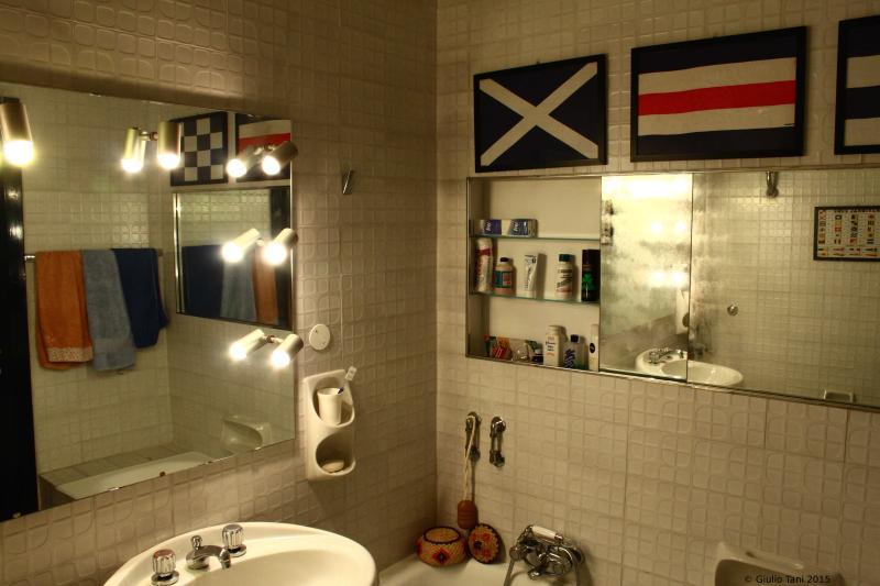 Bathroom with bathtub and double sink.
