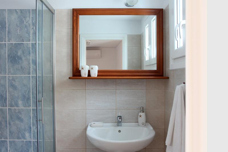 Light and airy, the second bathroom is on the top floor.