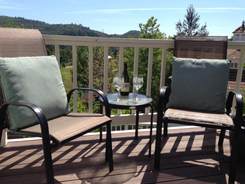 Enjoy a glass of wine on the sunny deck whilst taking in the scenery.