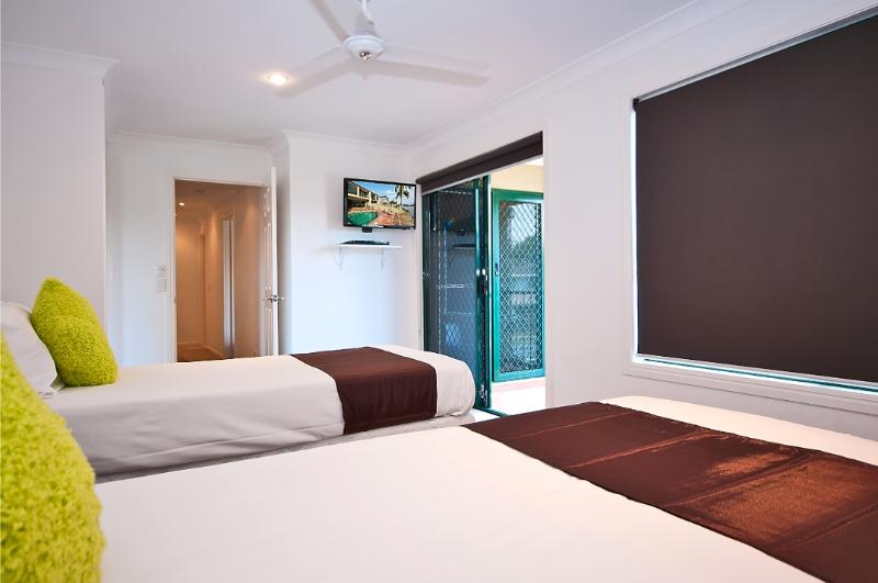 Bedroom 3 - Air Conditioned, TV, Bluray Player, Shared Balcony with Bedroom 2.