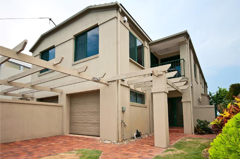 Off street parking for 2 cars. Intercom on front gate, remote controlled driveway gate & garage door
