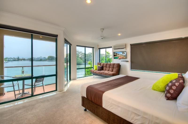 Main Bedroom with Click Down Couch and extensive River and Mountain Views