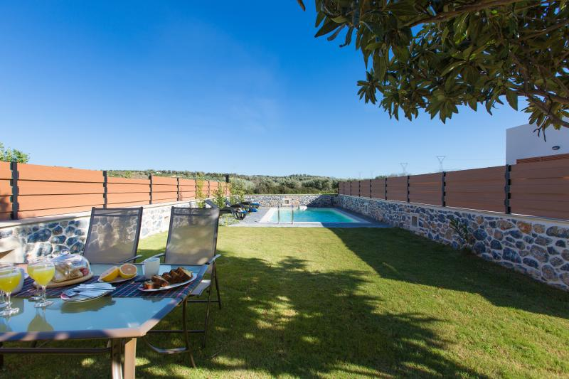 Private swimming pool area and outdoor dining area