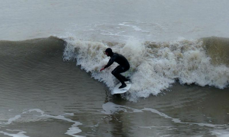 Surfing the waves at nearby Highcliffe Beach