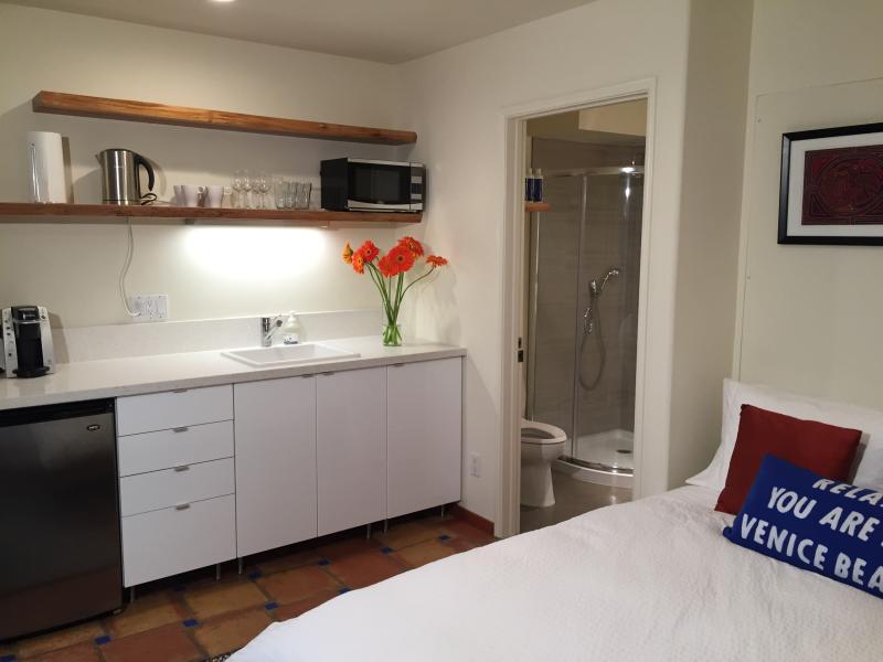 Kitchen and bathroom.