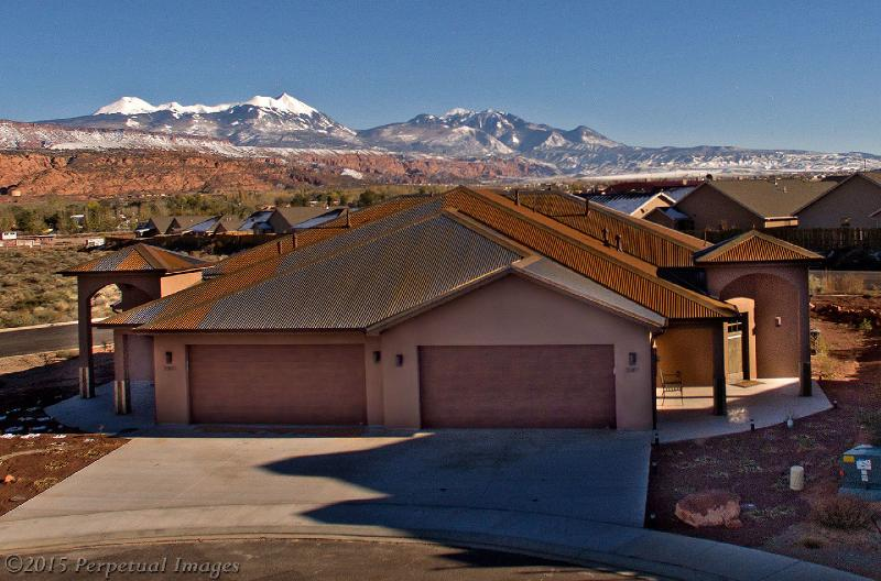 Front view with LaSal Mtn range in background. Adjoining unit also available.