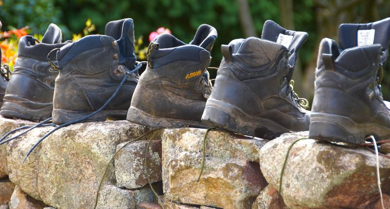 Walking boots airing on our pink granite dry stone walls