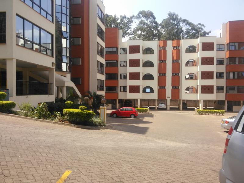 Royal Apartments: Ample parking space for residents and visitors.