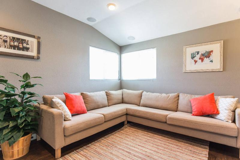 SUPER comfy couch with seating for 6. Extra guests can sleep on couch or an air bed.