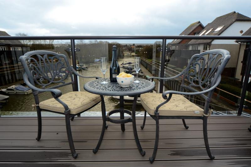 New glass fronted balcony with spiral staircase down to the deck. Now 6 seater table and chairs